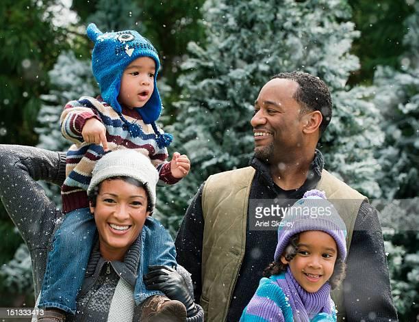 Smiling Black family enjoying the snow