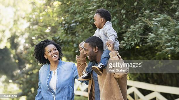 Smiling Black family in park