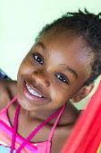 Smiling Black girl with braces diagonal portrait