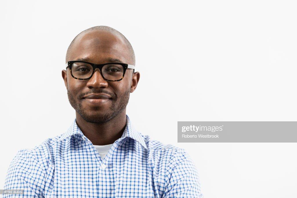 Smiling Black man wearing eyeglasses
