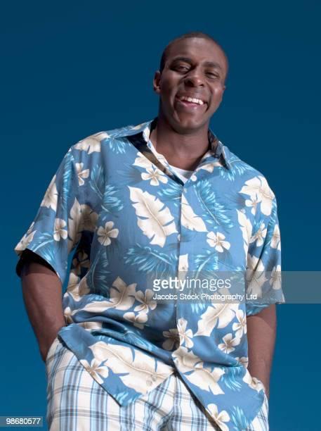 Smiling black man wearing Hawaiian shirt