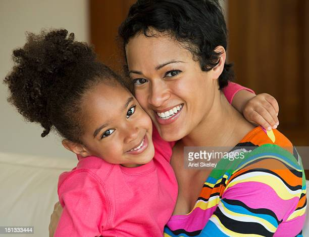 Smiling Black mother and daughter
