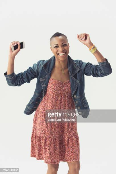 Smiling Black woman cheering