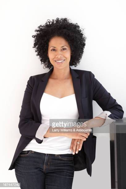 Smiling Black woman with hands clasped