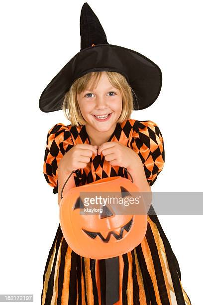 A smiling blond girl dressed as a witch for Halloween