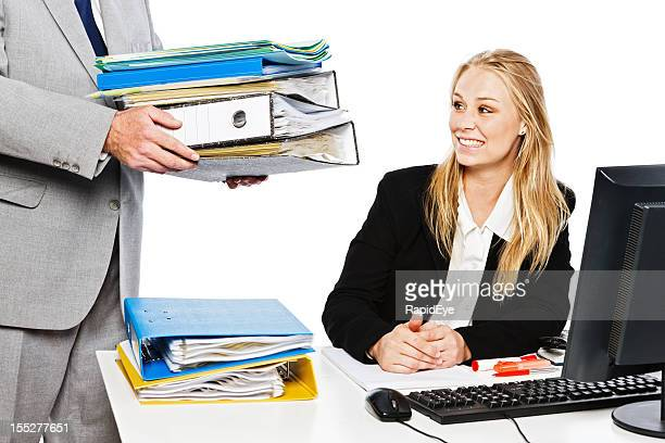 Smiling blonde businesswoman happily accepts even more work
