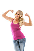 Smiling blonde woman flexing muscles