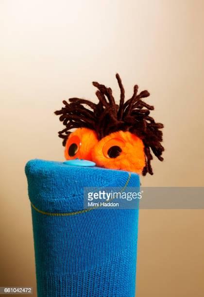 Smiling Blue Sock Puppet Looking Upward