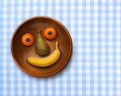Smiling bowl of fruit on gingham