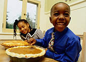 Smiling Boy and Girl Looking at Pies