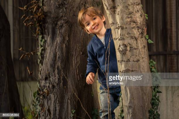 smiling boy autumn tree