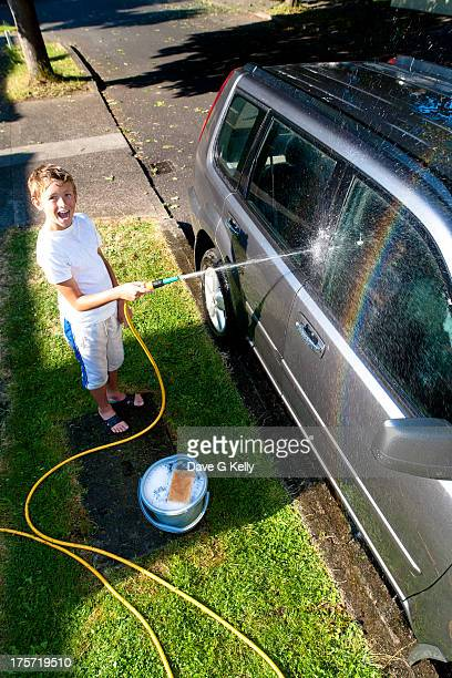 Smiling Boy Cleaning Car