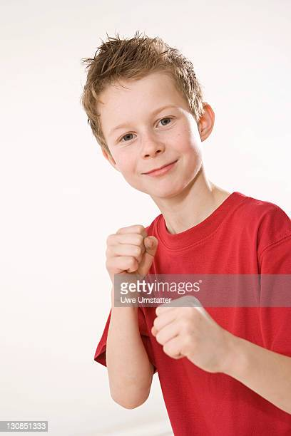 Smiling boy clenching his fists