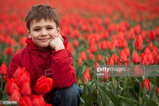 smiling boy in flowers