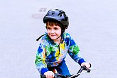 Smiling Boy On Bicycle Looking Away
