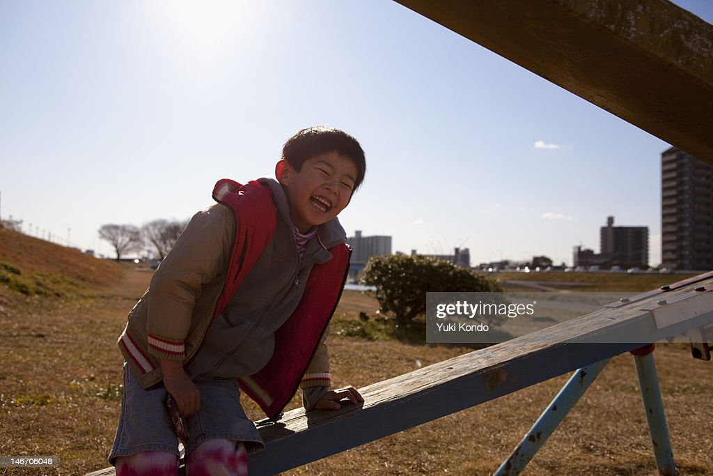Smiling boy playing in the playground equipment. : Stock Photo