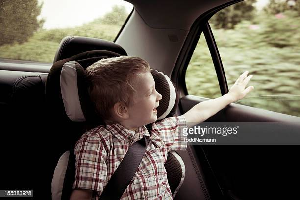 Smiling Boy Riding in a Car