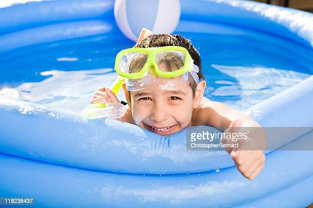 Smiling boy swimming outdoor