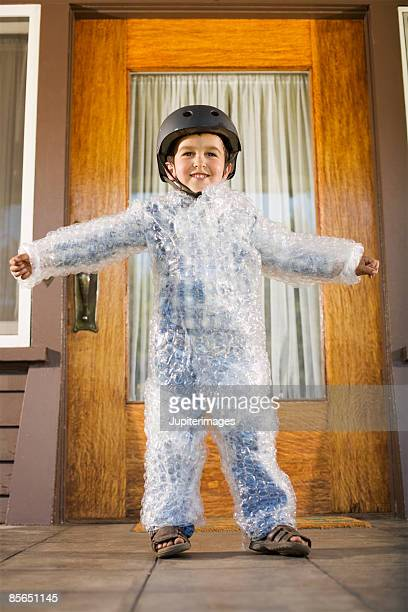 Smiling boy wearing bubble wrap and helmet