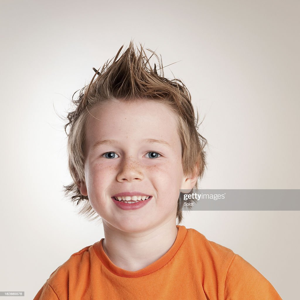 Smiling boy with freckles and spiky hair
