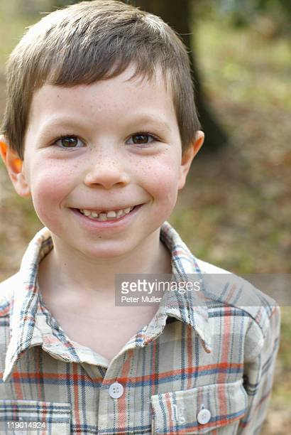 Smiling boy with missing tooth