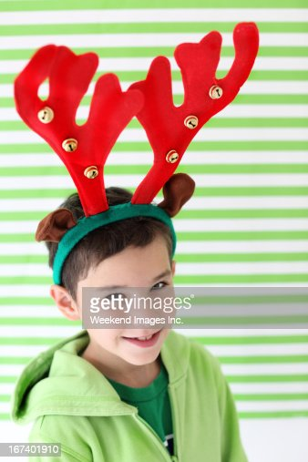 Smiling boy with red horns : Stock Photo