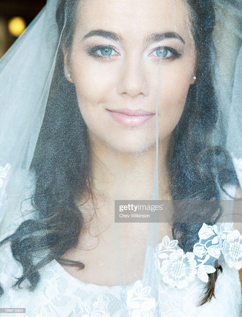 Smiling bride wearing veil