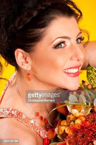Smiling bride with orange dress