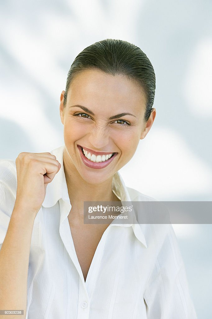Smiling brunette woman with a success mimic : Stock Photo