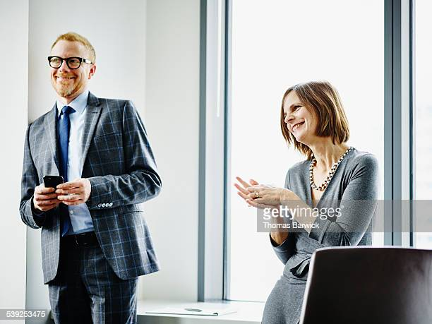 Smiling business executives in office meeting