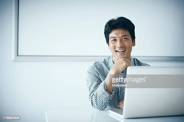 Smiling Business man sitting at a desk