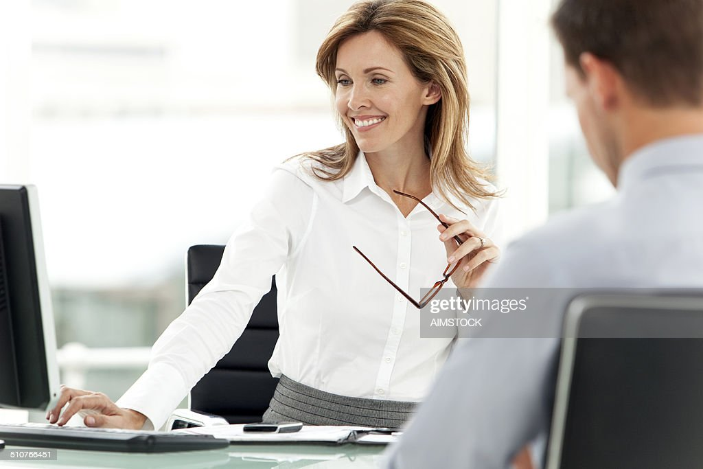 Smiling female manager at workplace