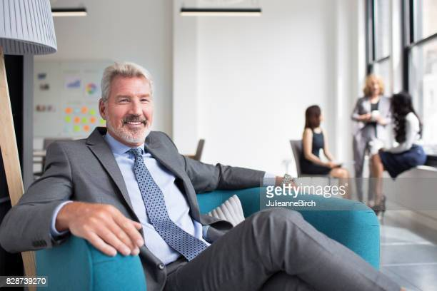 Smiling business manager in London office