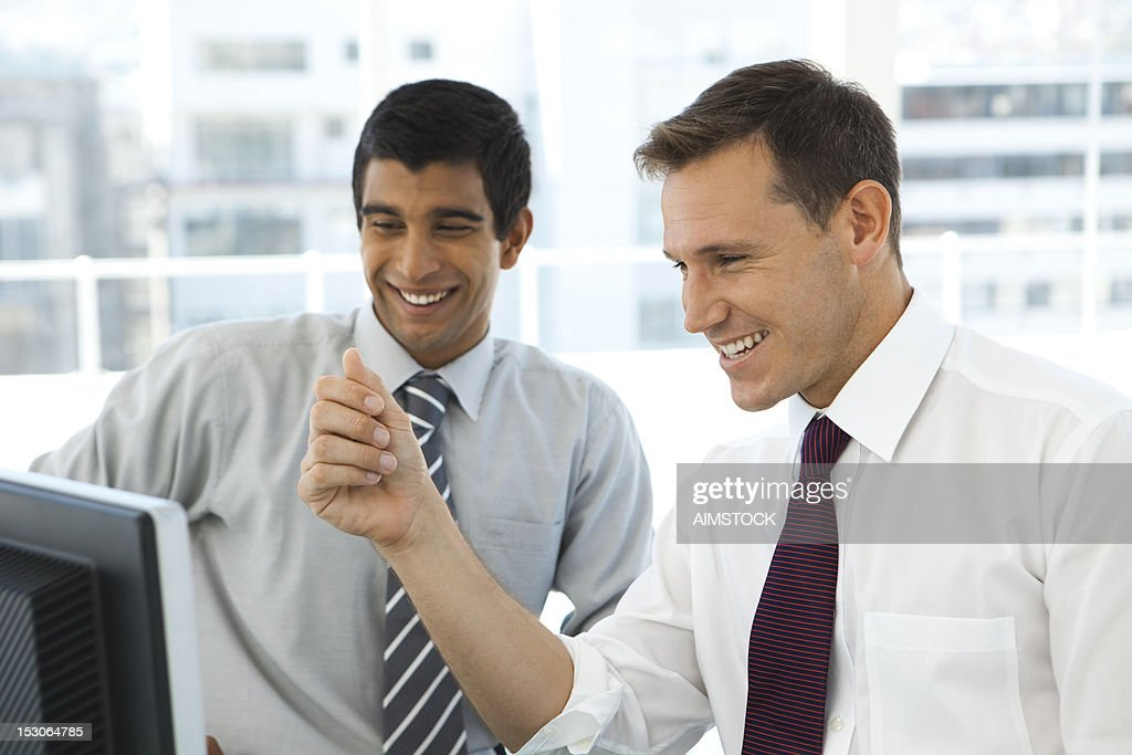 Smiling business partners : Stock Photo