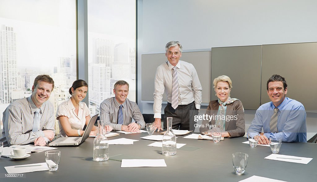 Smiling business people having a meeting in conference room : Stock Photo