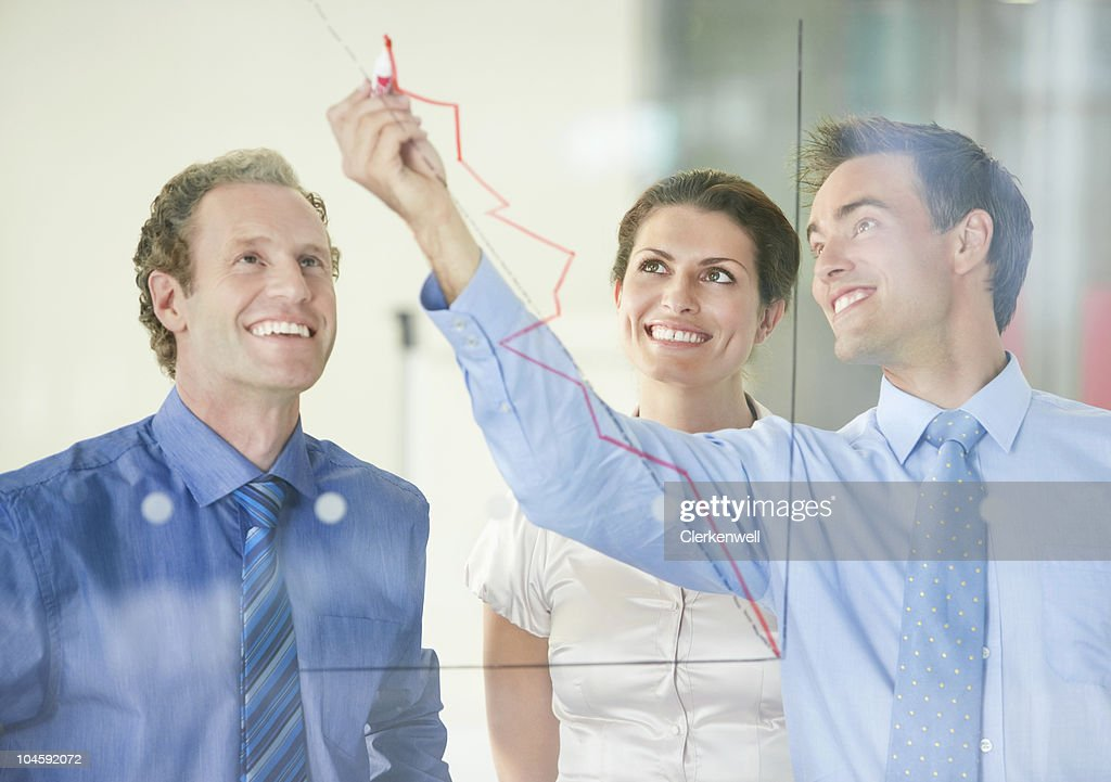 Smiling business people having a meeting on business development : Stock Photo