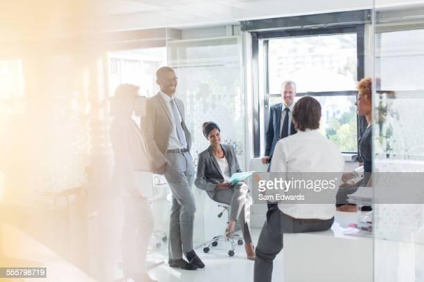 Smiling business people having meeting in modern in office