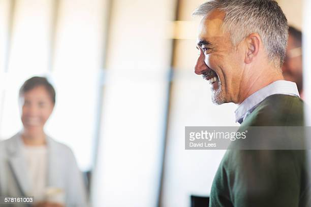 Smiling business people in meeting