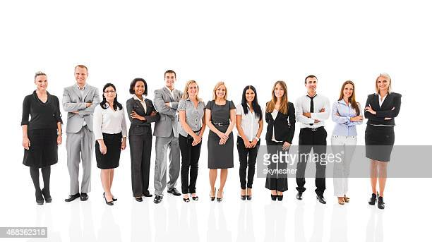 Smiling business people looking at the camera. Isolated on white.