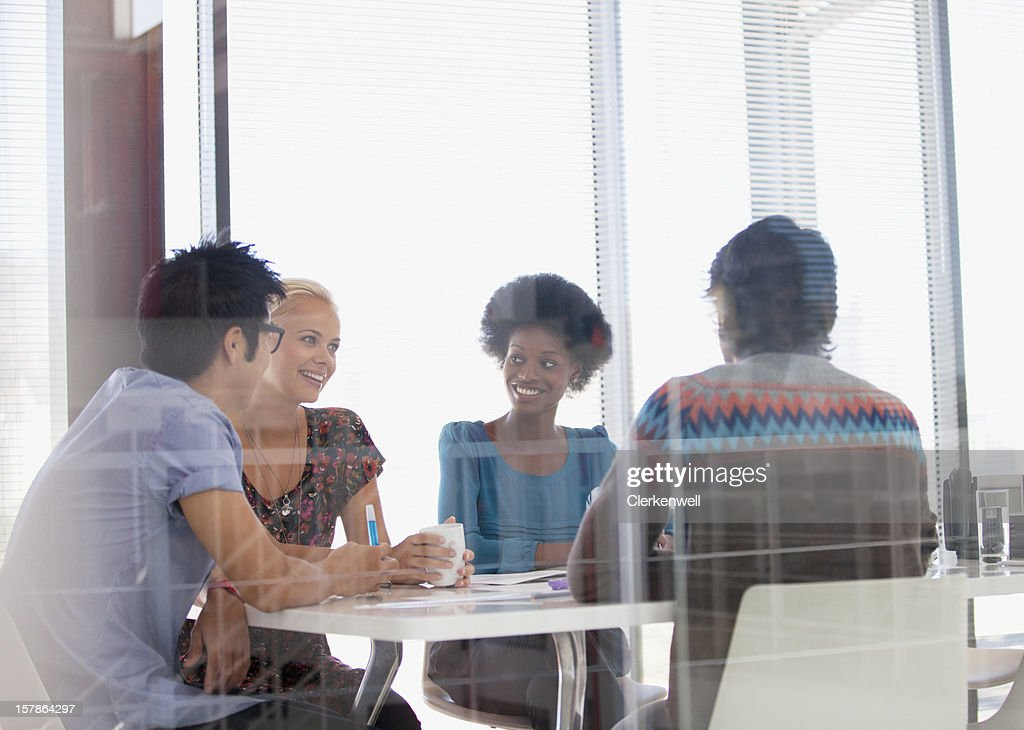 Smiling business people meeting in conference room : Stock Photo