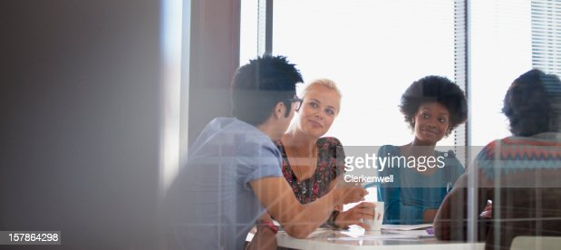 Smiling business people meeting in conference room