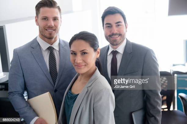 Smiling business people posing in office