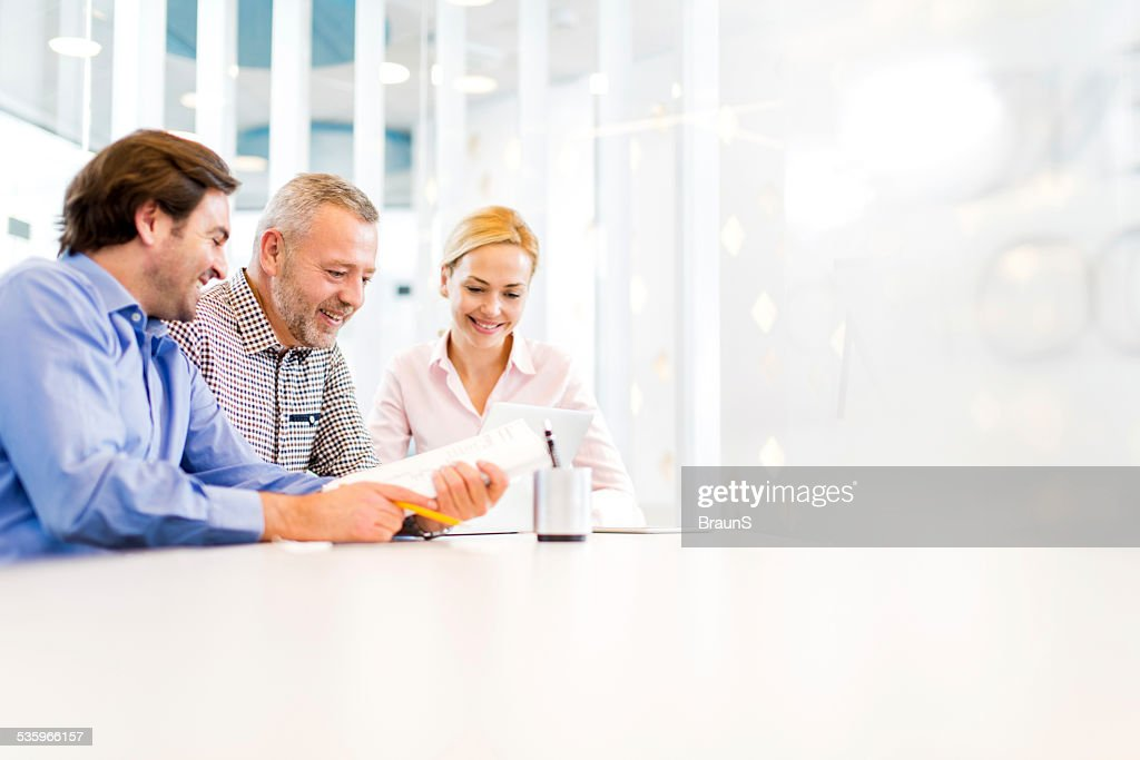 Smiling business people working in the office. : Stock Photo