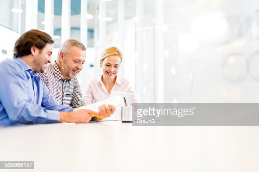 Smiling business people working in the office.