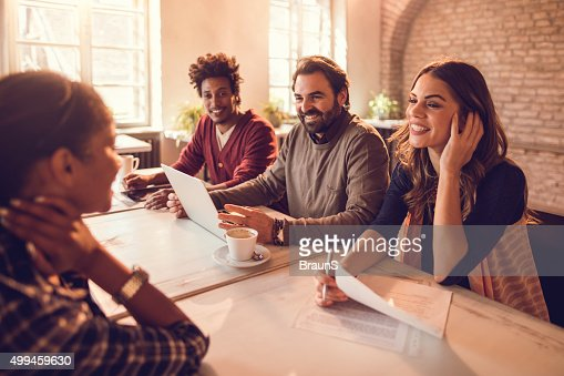 Smiling business team having a job interview with a candidate.