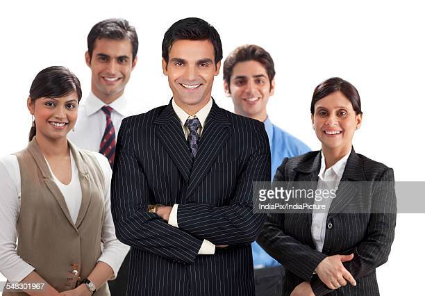 Smiling business team of confident male and female executives