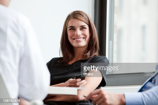 Smiling Business Woman in a Group Meeting : Stock Photo