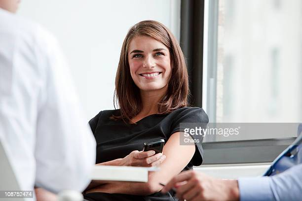 Smiling Business Woman in a Group Meeting