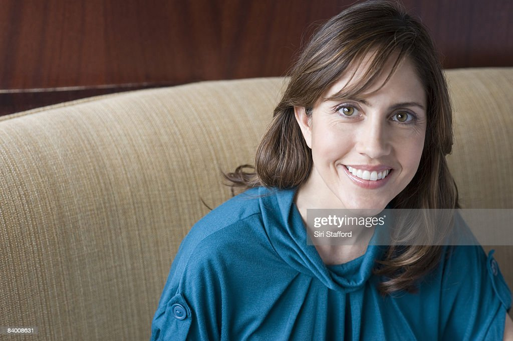 Smiling business woman in booth.  : Stockfoto