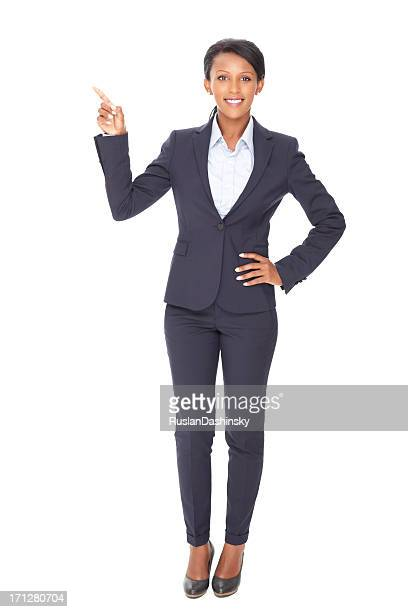 Smiling business woman pointing over copy space.